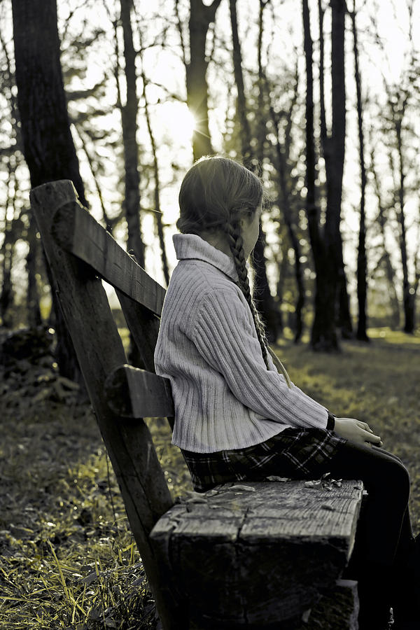 Girls Photograph - Girl Sitting On A Wooden Bench In The Forest Against The Light by Joana Kruse