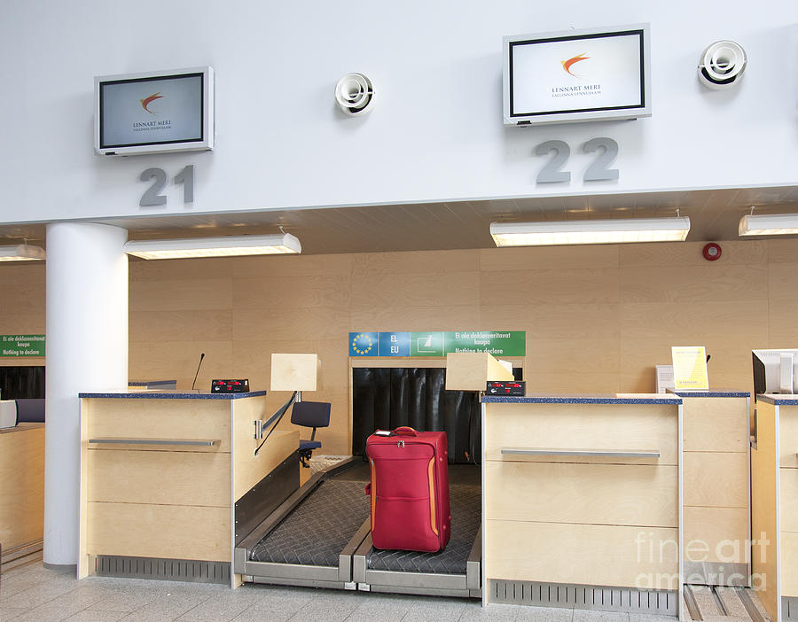 Air Travel Photograph - Luggage At An Airline Check-in Counter by Jaak Nilson