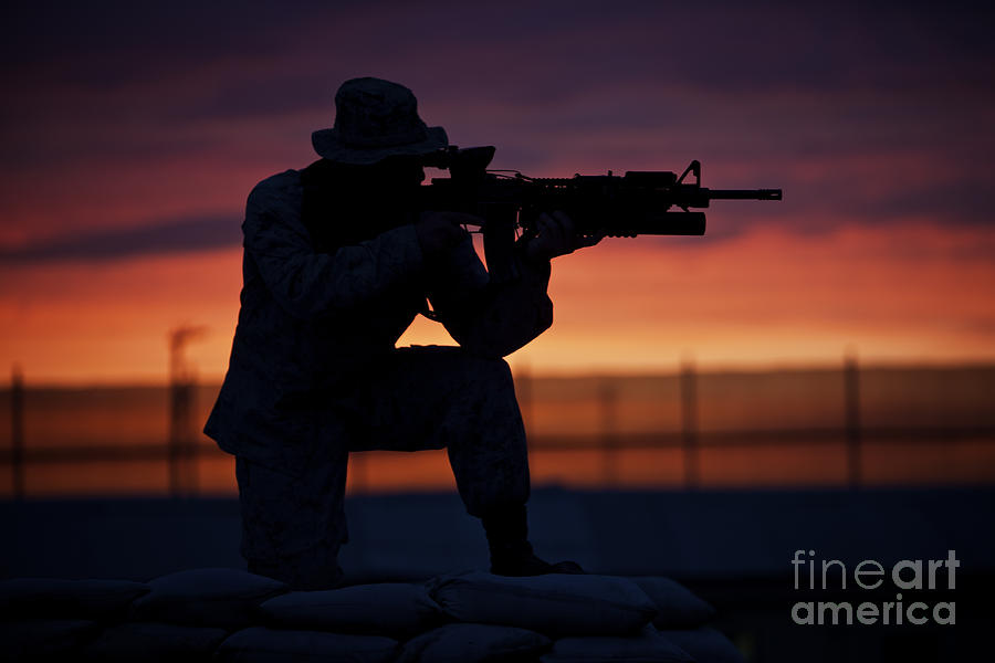 Afghanistan Photograph - Silhouette Of A U.s Marine On A Bunker by Terry Moore