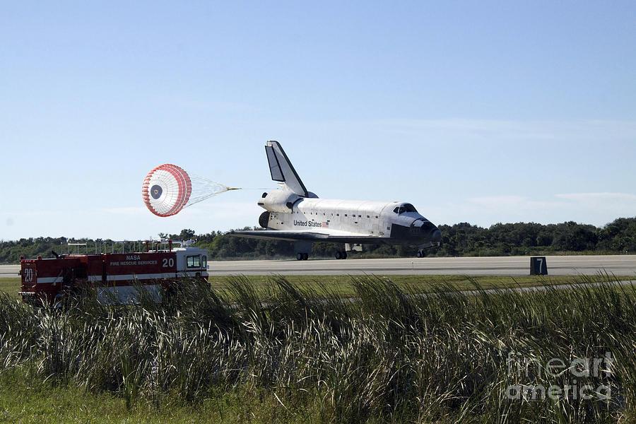 Achievement Photograph - Space Shuttle Atlantis Unfurls Its Drag by Stocktrek Images