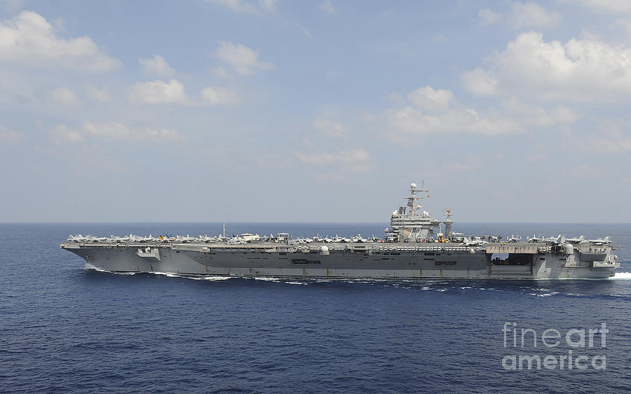 Blue Photograph - Uss Abraham Lincoln Transits The Indian by Stocktrek Images