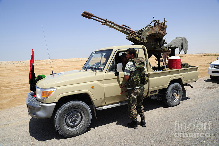 Civilians Photograph - A Free Libyan Army Pickup Truck by Andrew Chittock
