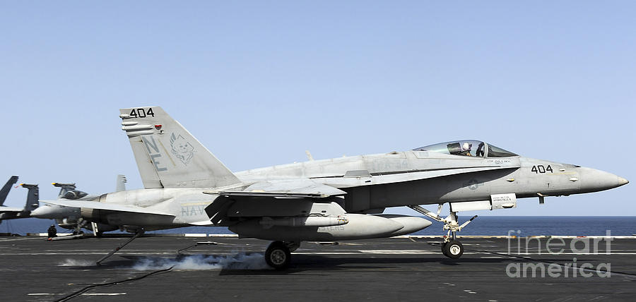 Us Navy Photograph - An Fa-18c Hornet Makes An Arrested by Stocktrek Images