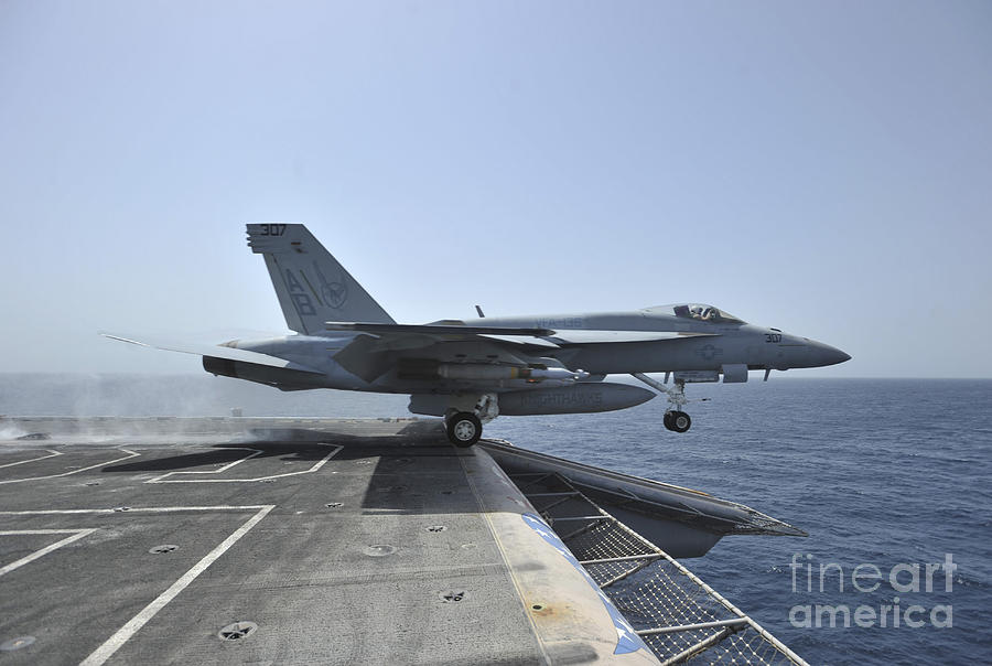 F/a-18e Super Hornet Photograph - An Fa-18e Super Hornet Launches by Stocktrek Images
