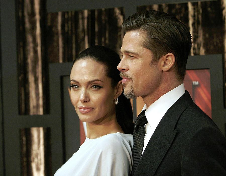 Awards Photograph - Angelina Jolie, Brad Pitt At Arrivals by Everett