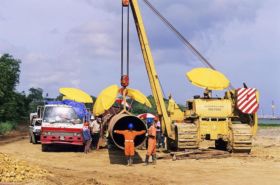 Human Photograph - Gas Line Construction by David Nunuk