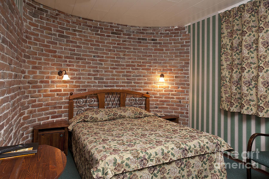 hotel bedroom interior with brick walls photograph by jaak. Black Bedroom Furniture Sets. Home Design Ideas