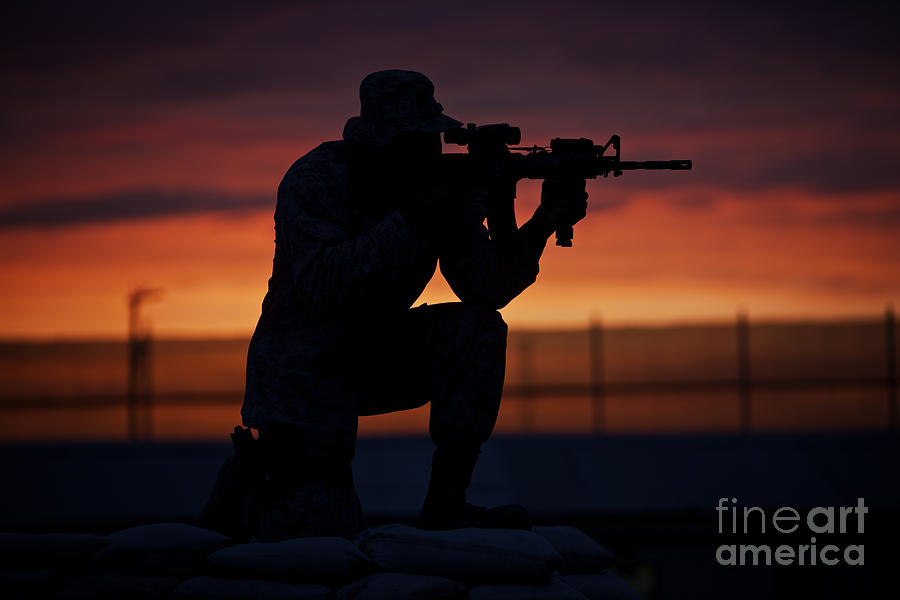 M16 Photograph - Silhouette Of A U.s Marine On A Bunker by Terry Moore
