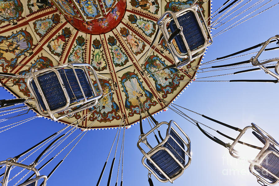Below Photograph - Swing Ride At The Fair by Jeremy Woodhouse