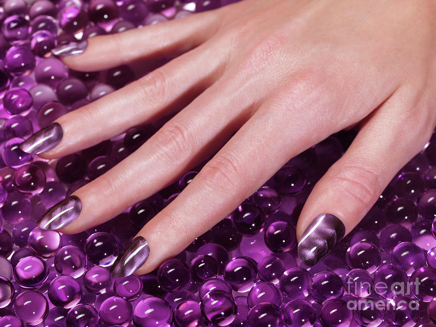Manicure Photograph - Woman Hand With Purple Nail Polish by Maxim Images Prints
