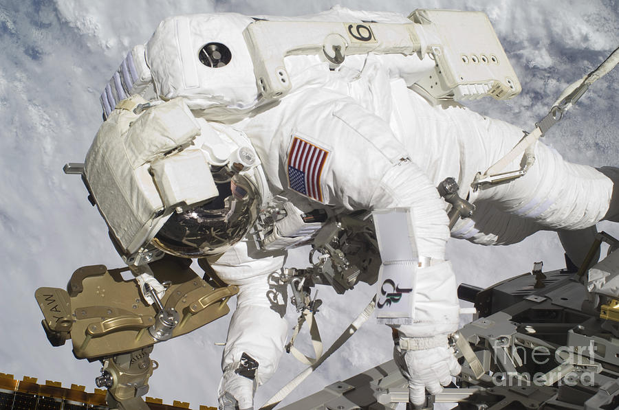 Components Photograph - An Astronaut Participates In A Session by Stocktrek Images