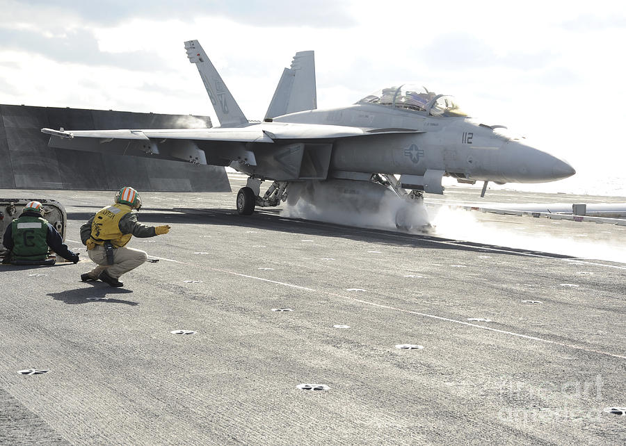 Military Photograph - An Fa-18f Super Hornet Launches by Stocktrek Images