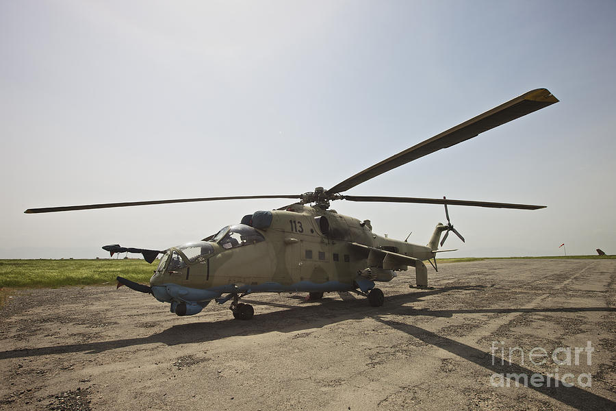 Kunduz Photograph - An Mi-35 Attack Helicopter At Kunduz by Terry Moore