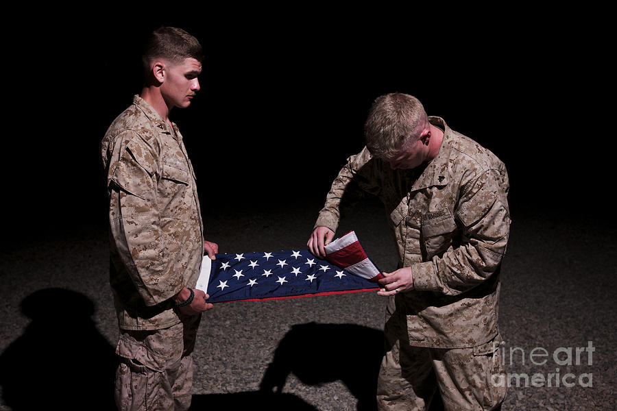 Afghanistan Photograph - U.s. Marines Fold The American Flag by Terry Moore