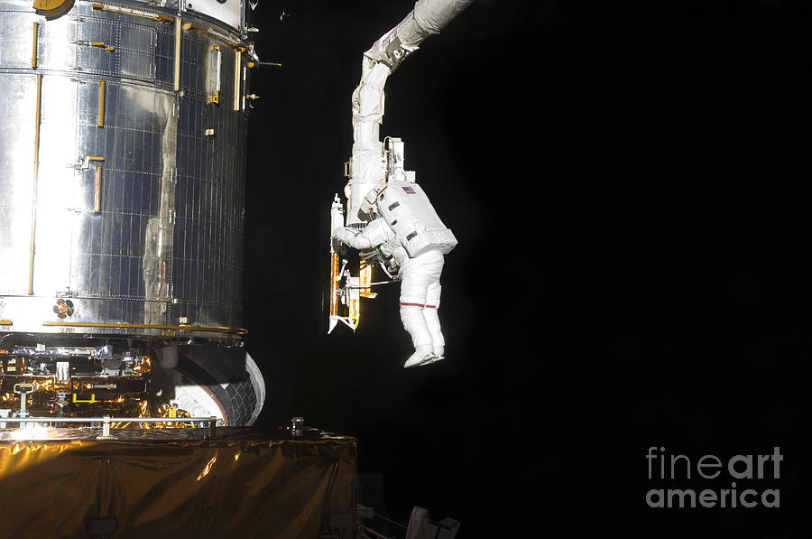 Space Exploration Photograph - Astronaut Working On The Hubble Space by Stocktrek Images