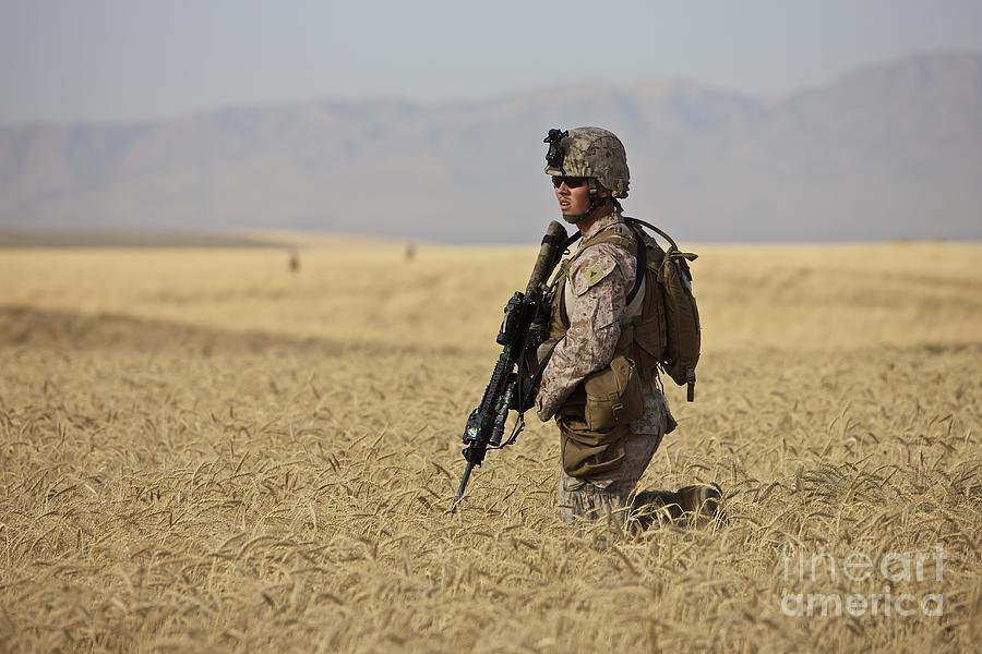 Afghanistan Photograph - U.s. Marine Patrols A Wadi Near Kunduz by Terry Moore