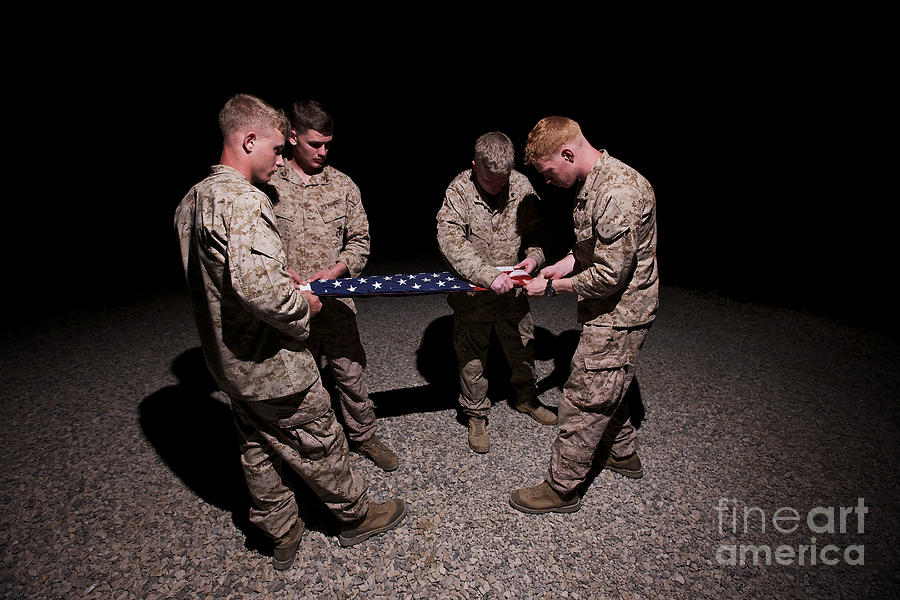 Folding Photograph - U.s. Marines Fold The American Flag by Terry Moore