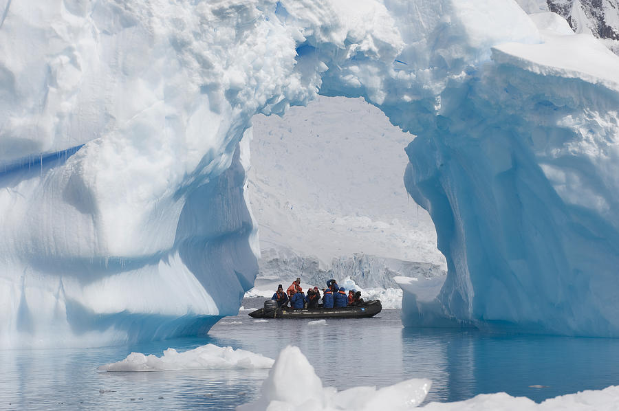 Iceberg Arch and Travelers Antarctica Photograph by Flip Nicklin