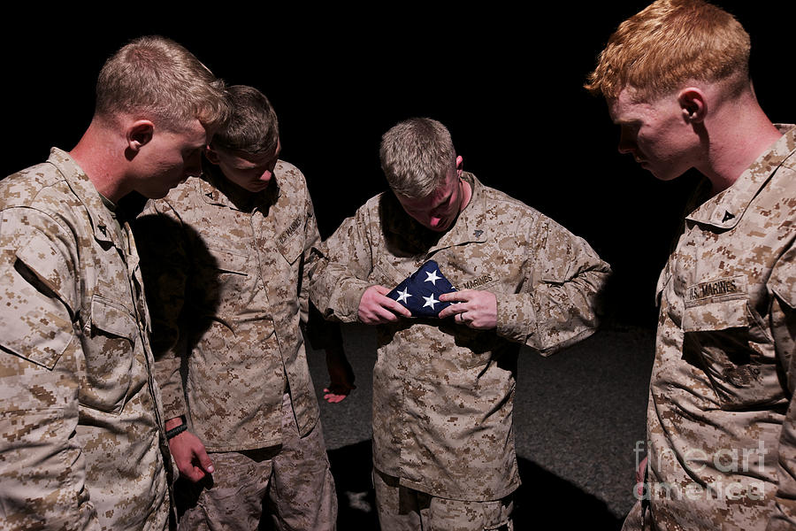 Us Marines Photograph - U.s. Marines Fold The American Flag by Terry Moore