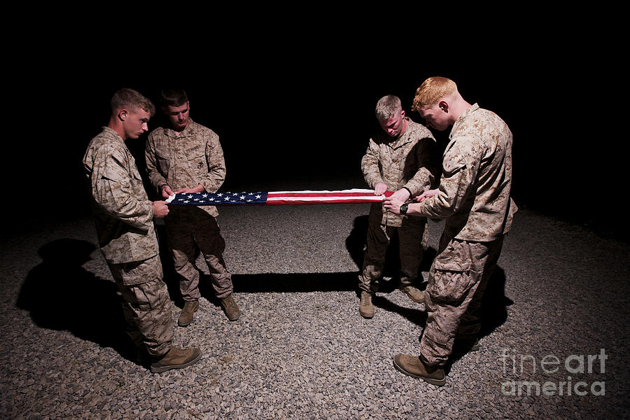 Night Photograph - U.s. Marines Fold The American Flag by Terry Moore