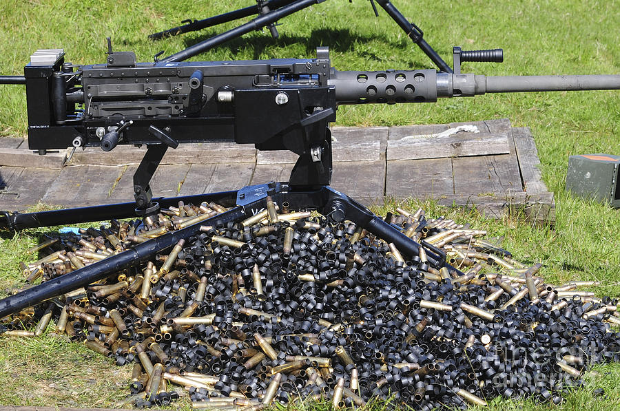 Abundance Photograph - A .50 Caliber Browning Machine Gun by Andrew Chittock