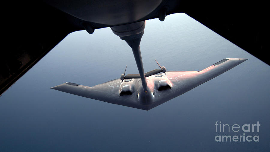 Aerial Photograph - A B-2 Spirit Bomber Conducts by Stocktrek Images