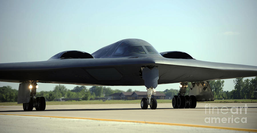 Missouri Photograph - A B-2 Spirit Taxis Onto The Flightline by Stocktrek Images