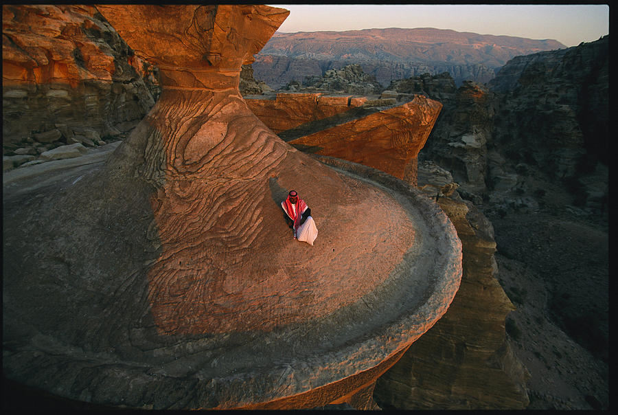 Color Image Photograph - A Bedouin Surveys The View by Annie Griffiths