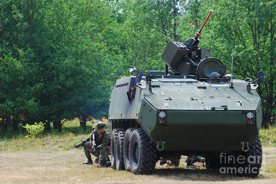 Land Component Photograph - A Belgian Army Piranha IIic With The Fn by Luc De Jaeger