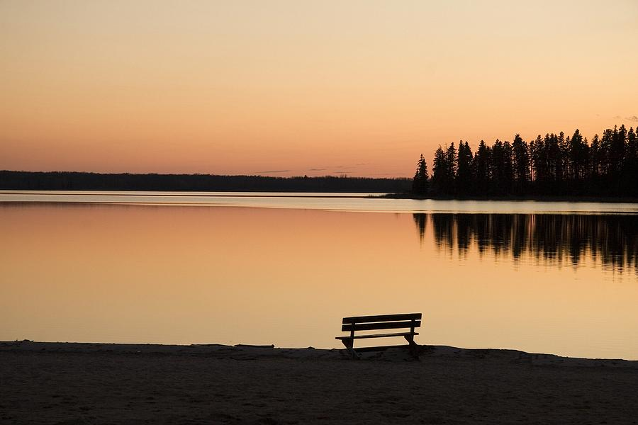 Bench Photograph - A Bench Silhouetted At Sunset Near The by Eryk Jaegermann