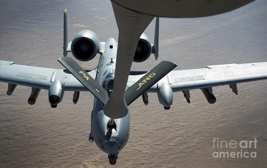 Aerial Refueling Photograph - A Boom Operator Refuels An A-10 by Stocktrek Images