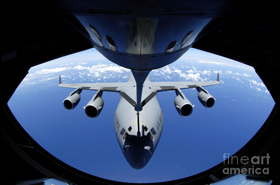 Aerial Photograph - A C-17 Globemaster IIi Receives Fuel by Stocktrek Images