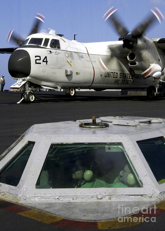 Color Image Photograph - A C-2a Greyhound Prepares For Launch by Stocktrek Images