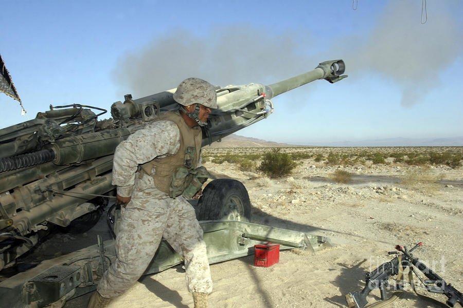 Artillery Photograph - A Cannoneer Uses His Body To Pull by Stocktrek Images
