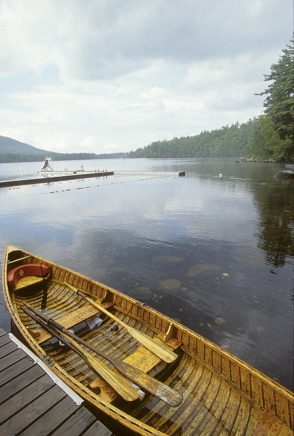 No People Photograph - A Canoe Floats Next To A Dock by Skip Brown