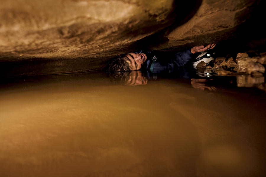 A Caver Moving In A Tight Space Photograph By Stephen Alvarez
