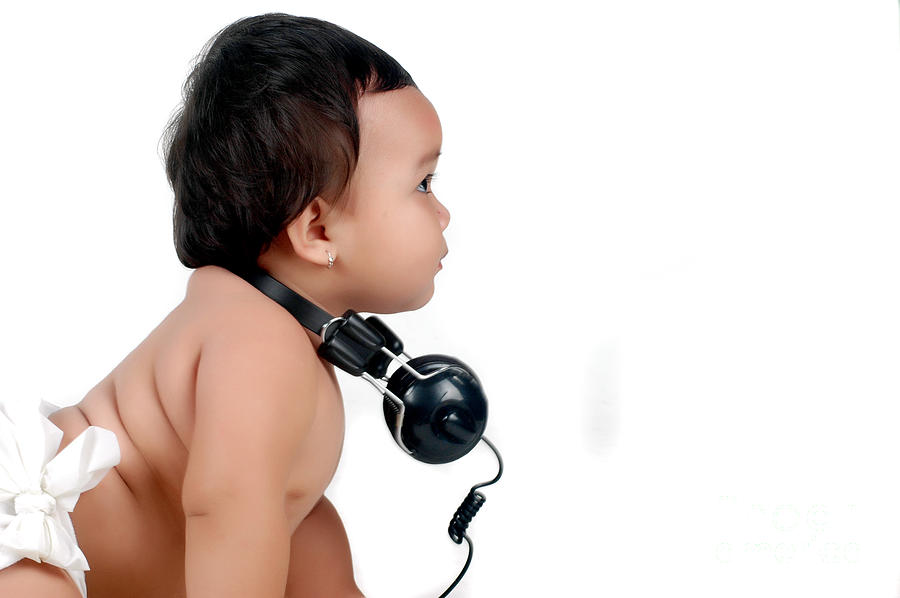 Baby Photograph - A Chubby Little Girl With Headphones by Antoni Halim