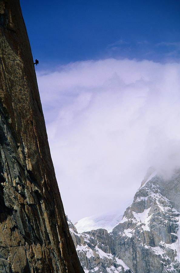 Color Image Photograph - A Climber Rappels Down The Sheer by Bill Hatcher