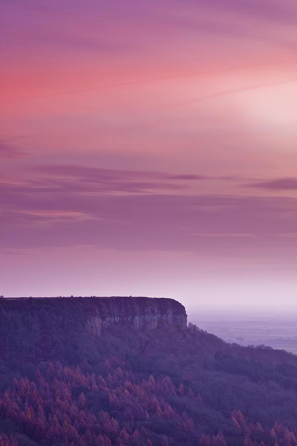 Vertical Photograph - A Colourful Sunset Over Sutton Bank by Julian Elliott Ethereal Light