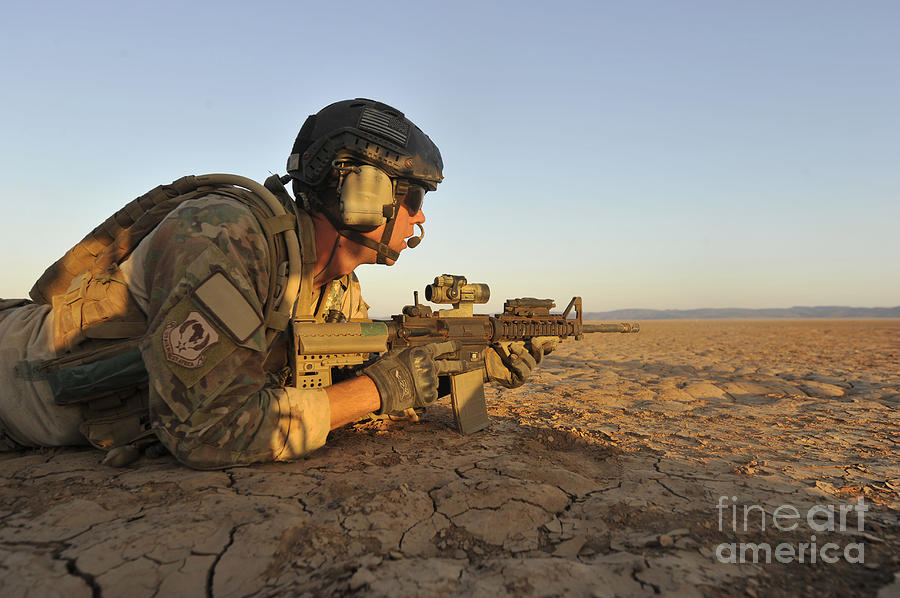 Holding Photograph - A Combat Rescue Officer Provides by Stocktrek Images