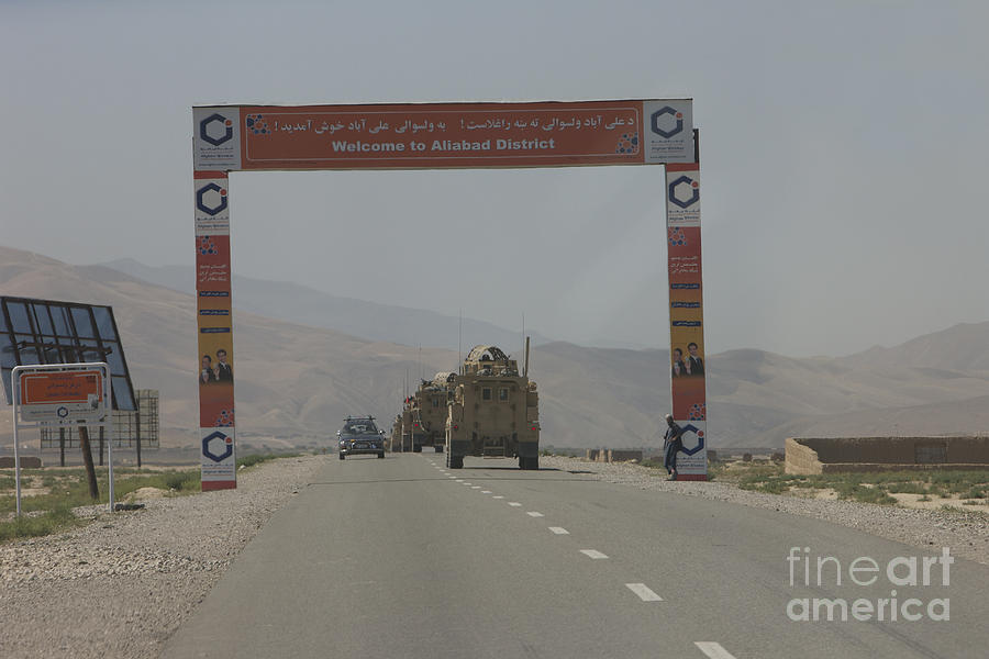 Afghanistan Photograph - A Convoy Of Cougar Mraps Driving by Terry Moore