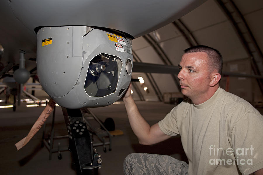 Gimbal Photograph - A Crew Chief Works On Mq-1 Predators by HIGH-G Productions