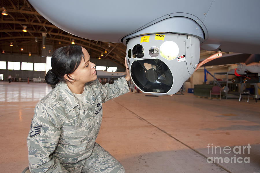 Unmanned Aerial Vehicles Photograph - A Crew Chief Works On Mq-9 Reapers by HIGH-G Productions