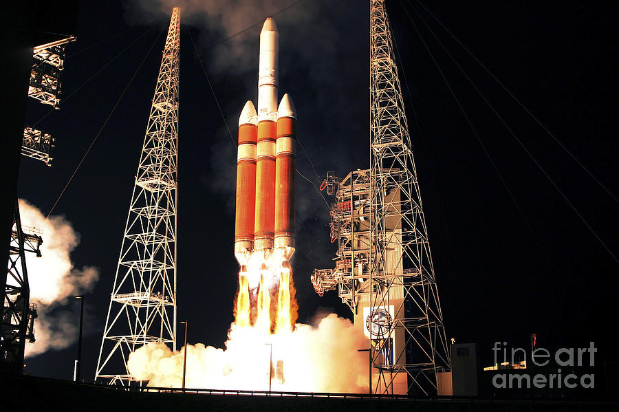 Space Photograph - A Delta Iv Heavy Rocket Lifts Off by Stocktrek Images
