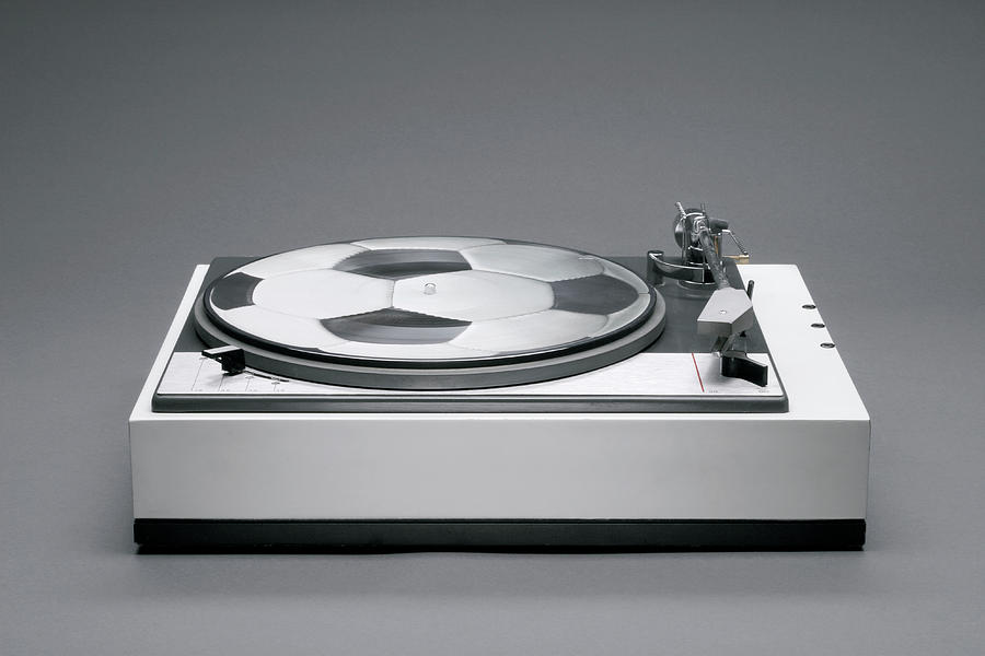 Horizontal Photograph - A Disk With A Soccer Print On A Record Player by Benne Ochs