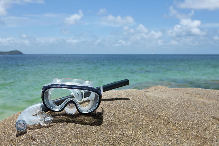 Horizontal Photograph - A Diving Mask And Snorkel On A Rock Near The Sea by Caspar Benson