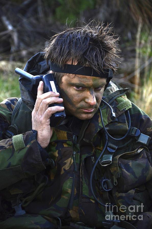 United Kingdom Photograph - A Dutch Patrol Commander Communicates by Andrew Chittock
