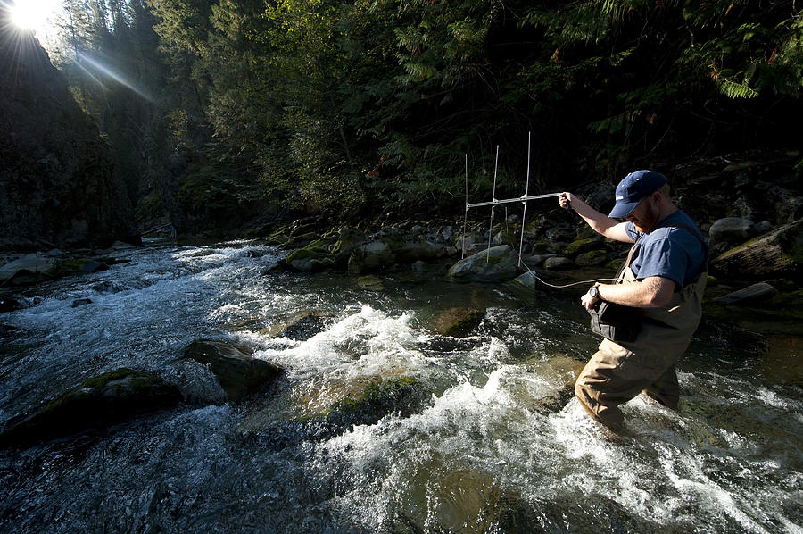 Outdoors Photograph - A Fisheries Technician Uses An Antenna by Joel Sartore