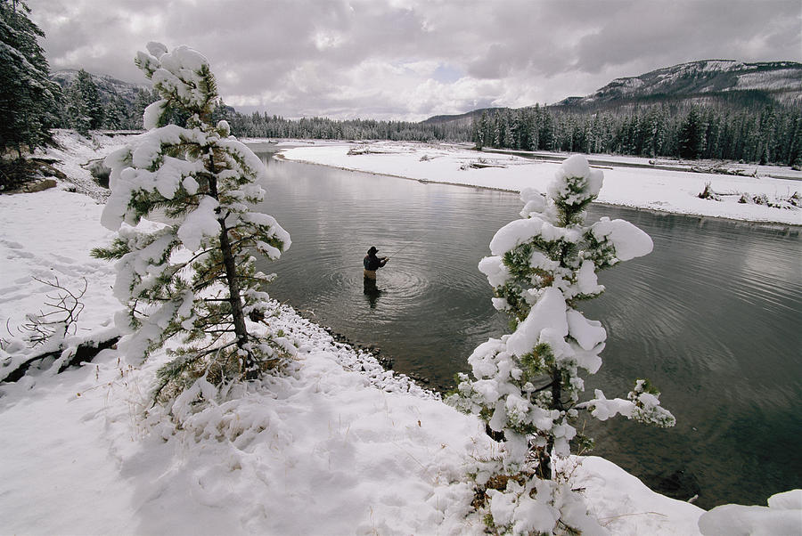 Color Image Photograph - A Fisherman Tries His Luck by Annie Griffiths