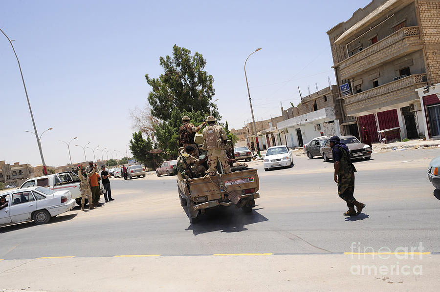 Libya Photograph - A Free Libyan Army Pickup Truck by Andrew Chittock